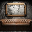 Leather sofa and frame in dark room — Stock fotografie