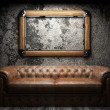 Leather sofa and frame in dark room — Stockfoto