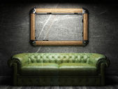 Leather sofa and frame in dark room — Stock Photo