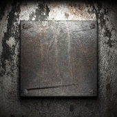 Iron plate on wall — Stock Photo