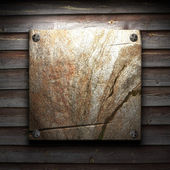 Stone plate on wall — Stock Photo