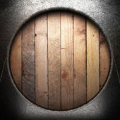 Metal on wooden wall — Stock Photo