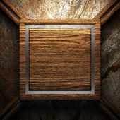 Wooden plate on wall — Stock Photo