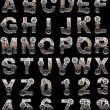Wooden alphabet with gears - Stock Photo