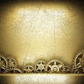 Зубчатые колеса на золото — Стоковое фото