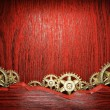 Gear wheels on wood — Stock Photo