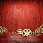 Gear wheels on wood — Stock Photo #21803683