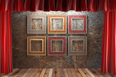 Red fabric curtain with frames — Stock Photo