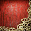 Gear wheels on wood - Stock Photo