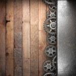 Gear wheels on wood — Stock Photo #22111333