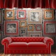 Red fabric curtain with frames and sofa - Foto Stock