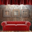 Red fabric curtain with frames and sofa — Stock Photo