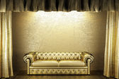 Golden curtain with sofa — Stock Photo
