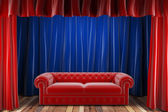 Red fabric curtain with sofa — Stock Photo