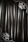 Metal on black curtain — Stock Photo