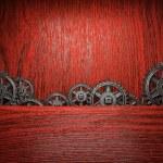 Gear wheels on wood — Stock Photo