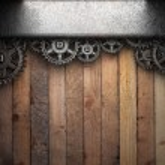 Gear wheels on wood — Stock Photo #23599063