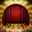 Red fabric curtain on golden stage — Stock Photo #23976927