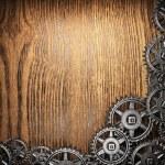 Gear wheels on wood — Stock Photo #23977007