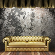 Royalty-Free Stock Photo: Golden curtain with sofa