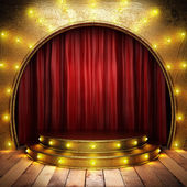 Red fabric curtain on golden stage — Stockfoto