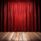 Red fabric curtain on stage — Stock Photo