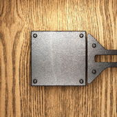 Metal on wood background — Stock Photo