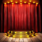Red fabric curtain on golden stage — 图库照片