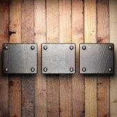 Metal on wood background — Stock Photo