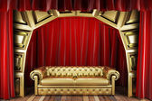 Red fabric curtain and sofa on golden stage — Stock Photo