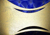 Gold on fabric background — Stock Photo