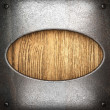 Metal on wood background - Stockfoto