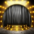 Black fabric curtain on golden stage — Stock Photo #26380183