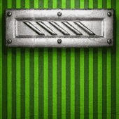 Metal on green background — Stock Vector