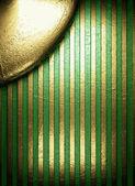 Ouro sobre fundo verde — Vetor de Stock