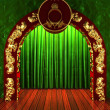Green fabric curtain with gold on stage — Stockfoto