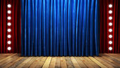 Blue fabrick curtain on stage — Stockfoto