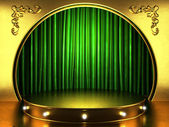 Green fabric curtain with gold on stage — Стоковое фото