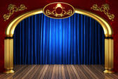 Blue fabric curtain on golden stage — Stock Photo