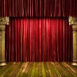 Stock Photo: Red fabric curtain on stage