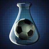 Football in Laboratory glassware on blue background — Stock Photo