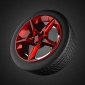 Car wheel on gray background — Stock Photo