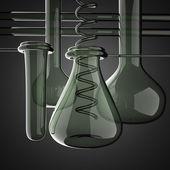 Laboratory glassware on gray background — Stock Photo