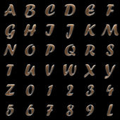 Metal and wood alphabet on black background — Stock Photo