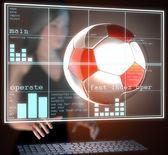 Soccer ball on hologram — Stock Photo