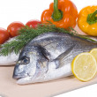 Stock Photo: Two Gilthead Fishes On Cutting Board