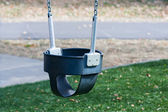 Close up of swings on empty playground — Foto Stock