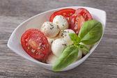 Mozzarella cheese,tomato and basil — Stock Photo