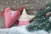 Wooden christmas star and heart decoration — Stock Photo