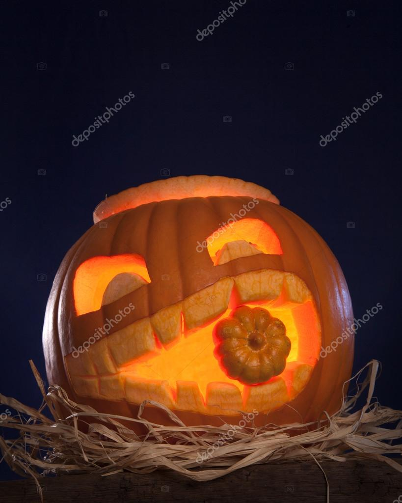 Halloween pumpkins on a wooden desk — Stock Photo #12752696